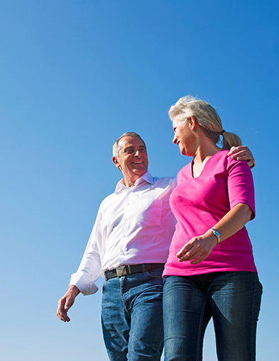 TFSA - older couple walking with blue sky in back ground